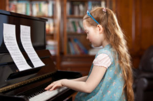 young piano student girl